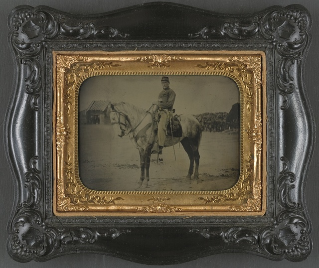 [Private Levi F. Hocker of Co. F, 17th Pennsylvania Cavalry Regiment, in uniform with pistol and sword, on horseback]