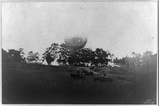 "[Prof. Thaddeus Lowe's ""Balloon Camp"" at Gaines Mill, Va., May 1862: balloon in backgrd. across field; horsemen in foregrd.]"