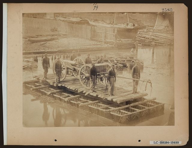 [Raft of blanket boats ferrying field artillery and soldiers across the Potomac River]