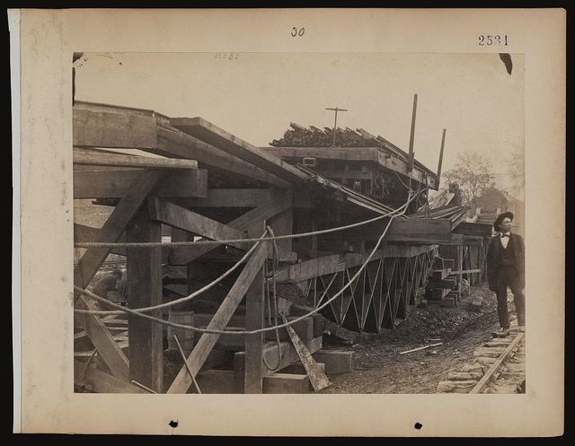 [Second experiment with board trusses, after it had been broken, and the boards removed from the sides to show the places of fracture]