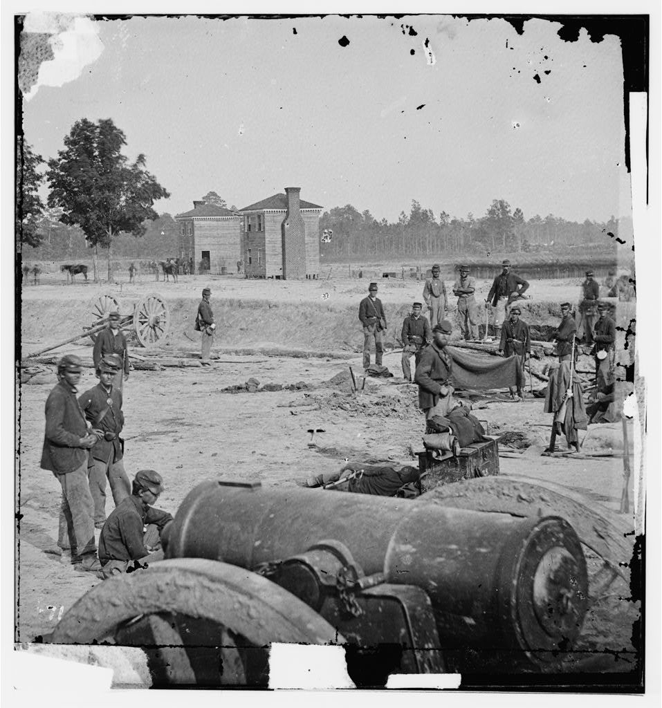 [Seven Pines, Va. Twin houses on battlefield, with 32-pdr. field howitzer in foreground]
