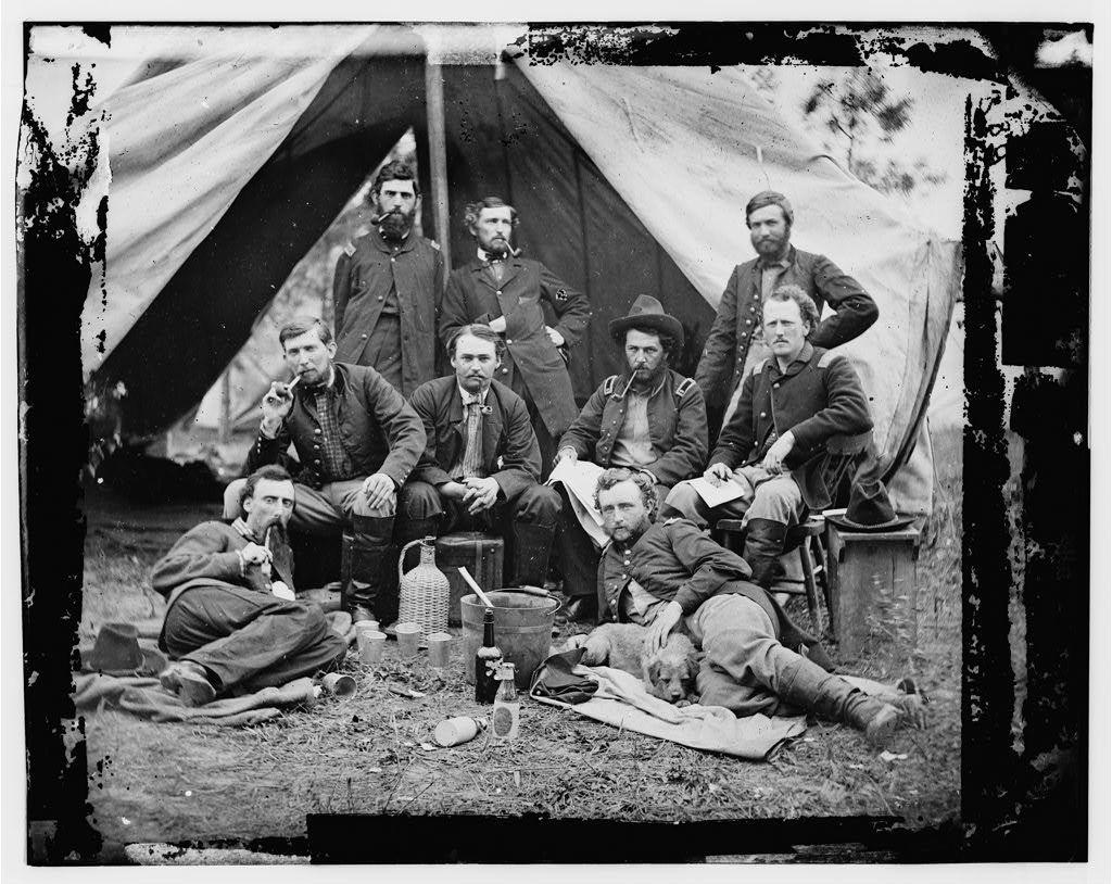[The Peninsula, Va. The staff of Gen. Fitz-John Porter; Lts. William G. Jones and George A. Custer reclining]