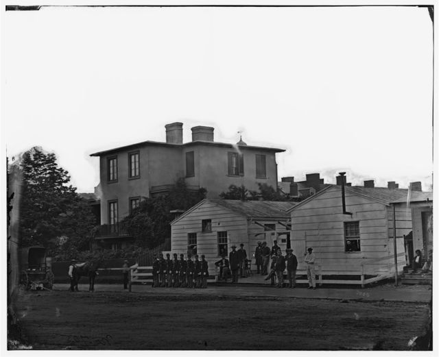 [Washington, District of Columbia]. Eight soldiers in formation in front of temporary buildings