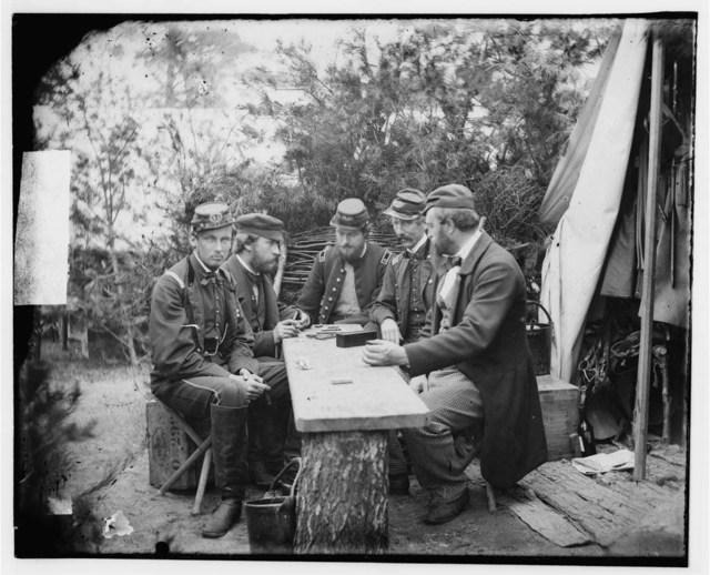 [Yorktown, Va., vicinity. Duc de Chartres, Comte de Paris, Prince de Joinville, and friends playing dominoes at a mess table, Camp Winfield Scott]