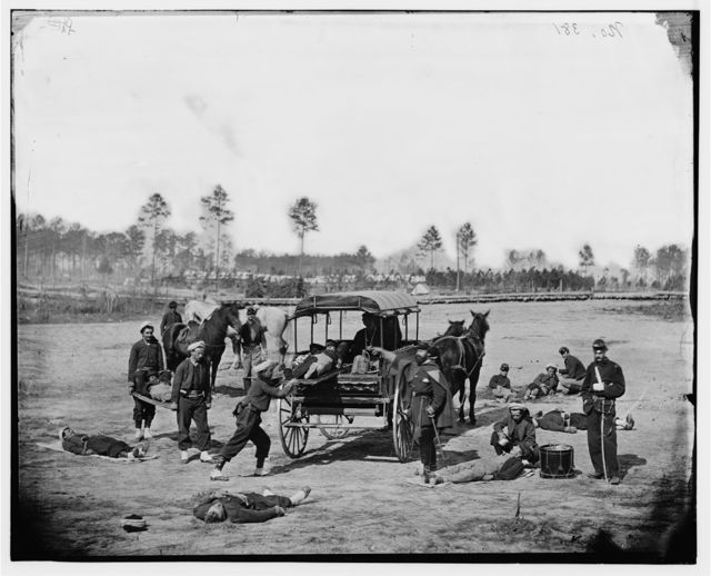 Zouave ambulance crew demonstrating removal of wounded soldiers from the field