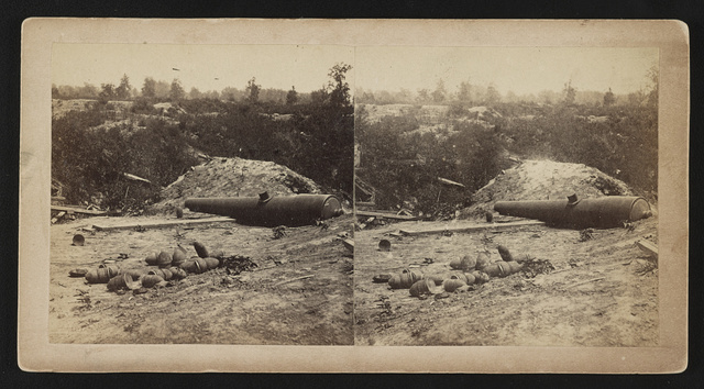 [Damaged cannon and artillery inside Port Hudson after the siege]