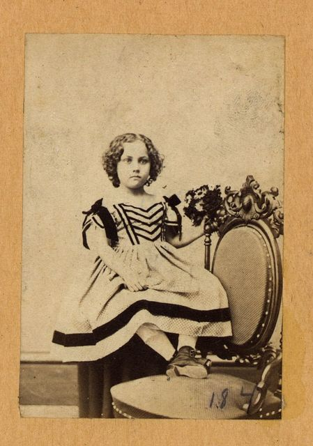 [Fannie Virginia Casseopia Lawrence, full-length portrait, seated, with feet on chair, facing front]