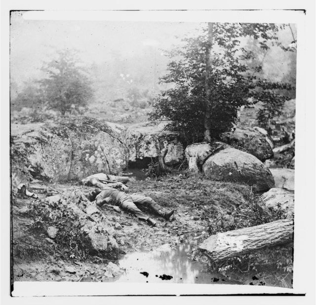 "[Gettysburg, Pa. Dead Confederate soldiers in the ""slaughter pen"" at the foot of Little Round Top]"