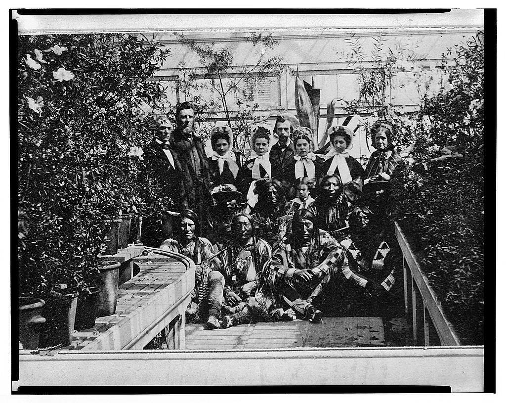 [Indian delegation in the White House Conservatory during the Civil War, with J.G. Nicolay, President Abraham Lincoln's secretary, standing in center back row ] / Brady, New York.