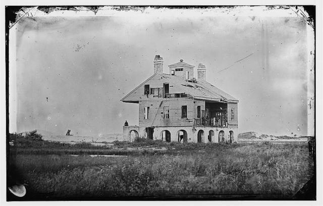 [Morris Island, South Carolina. The Beacon House after the struggle for Fort Wagner, July 18, 1863. It was the headquarters of General W.H. Davis of the 104th Pennsylvania and had also been used by General Gillmore as a signal station]
