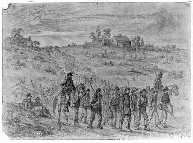 The battle of Gettysburg--Prisoners belonging to Gen. Longstreet's Corps captured by Union troops, marching to the rear under guard / E.F.