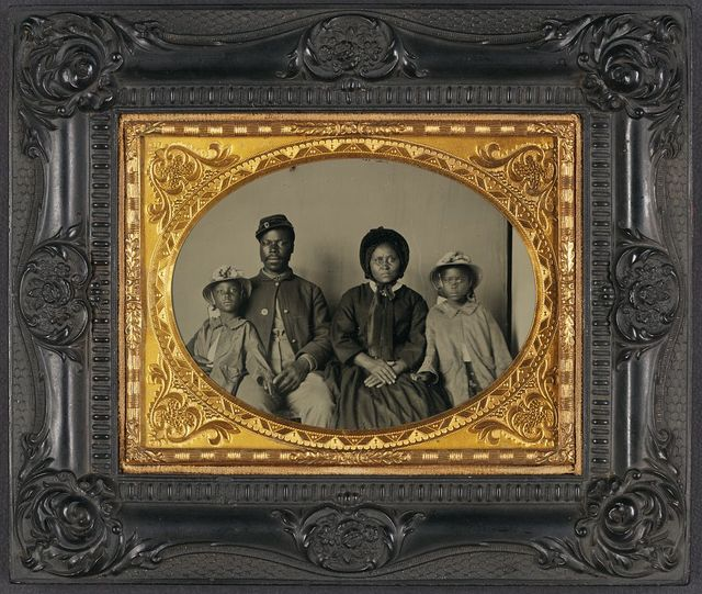 [Unidentified African American soldier in Union uniform with wife and two daughters]