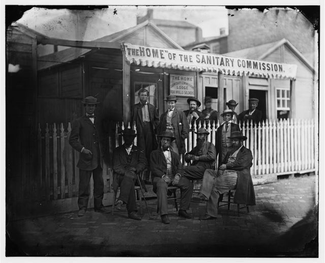 [Washington, D.C. Group of Sanitary Commission workers at the entrance of the Home Lodge]
