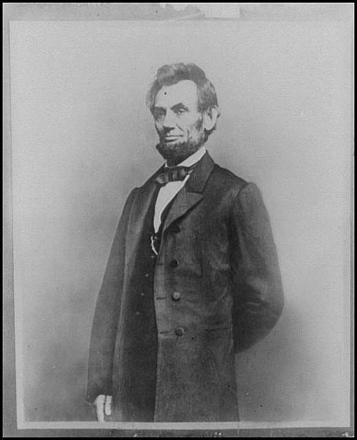 [Abraham Lincoln, three-quarter length portrait, standing, facing left