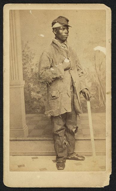 [African American man, full-length portrait, facing right] / photographic artist. B. Moses, Cor. Camp and Canal Sts., New Orleans.