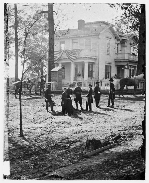Atlanta, Georgia. Federal officers standing in front of house. (Formerly headquarters of Gen. John Bell Hood.)