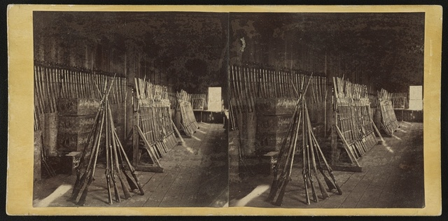 [Bayoneted rifles on racks at arsenal of 134th Illinois Volunteer Infantry, Columbus, Kentucky] / From Carbutt's Garden City Photographic Gallery. 131 Lake Street, Chicago.