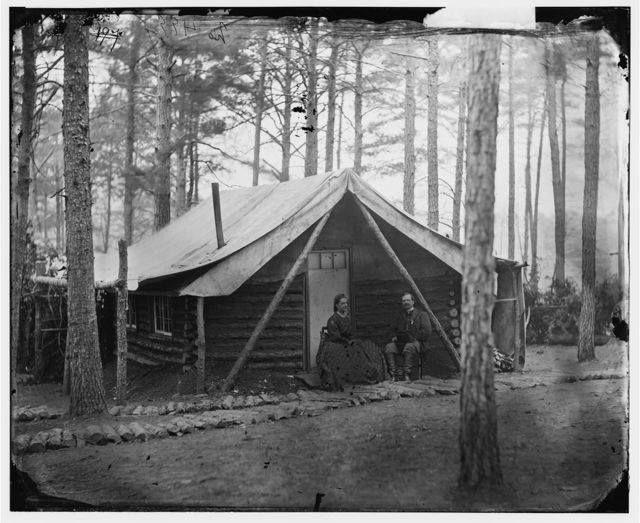 Brandy Station, Virginia. Col. John R. Coxe, A.C.S., and lady seated before his log-cabin winter quarters at Army of the Potomac headquarters