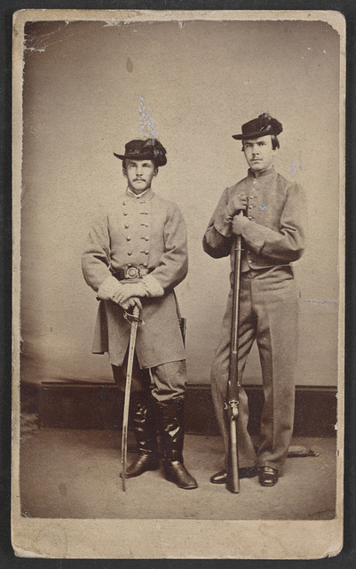 [Brothers James McHenry Howard (1838-1916), First Maryland Infantry, C.S.A. with sword (left) and Pvt. David Ridgely Howard (1844-1927), Second Maryland Infantry, C.S.A with rifle] / G.F. Maitland, successor to J. Inglis, St. Catharines.
