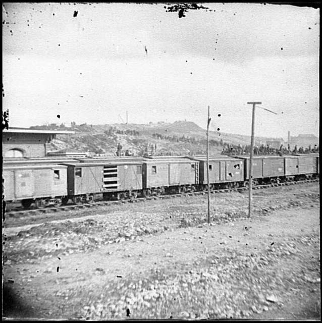 [Chattanooga, Tenn. Boxcars and depot with Federal cavalry guard beyond]