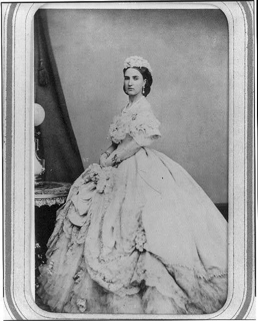 [Empress Carlota of Mexico, full-length portrait, standing, in formal gown, facing left]