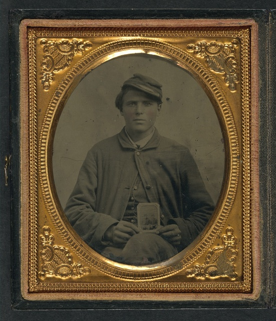 [Freeman Mason of Company K, 17th Vermont Infantry holding a tintype of his brother, Michael Mason, killed at Savage's Station, Virginia, in 1862]