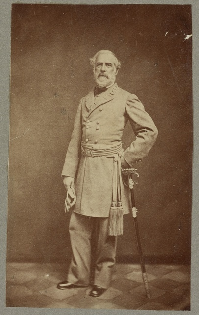 [General Robert E. Lee, full-length portrait, standing, facing front, with left hand at waist, on sword, wearing military uniform]
