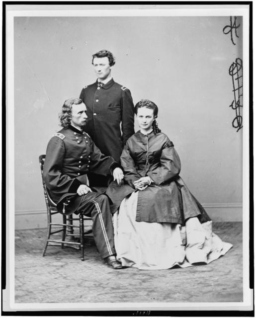 """[George Armstrong Custer, in uniform, seated with his wife, Elizabeth """"Libbie"""" Bacon Custer, and his brother, Thomas W. Custer, standing]"""
