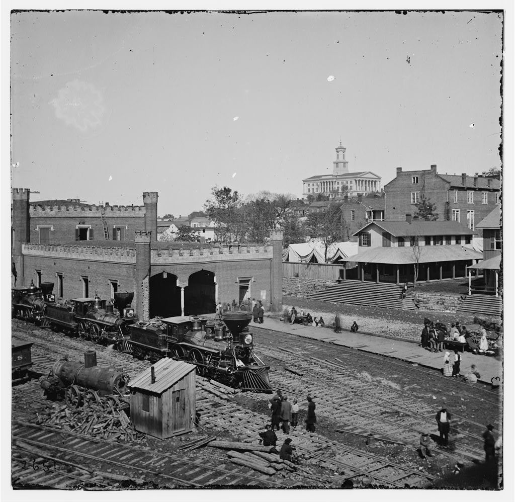 [Nashville, Tenn. Railroad yard and depot with locomotives; the Capitol in distance]