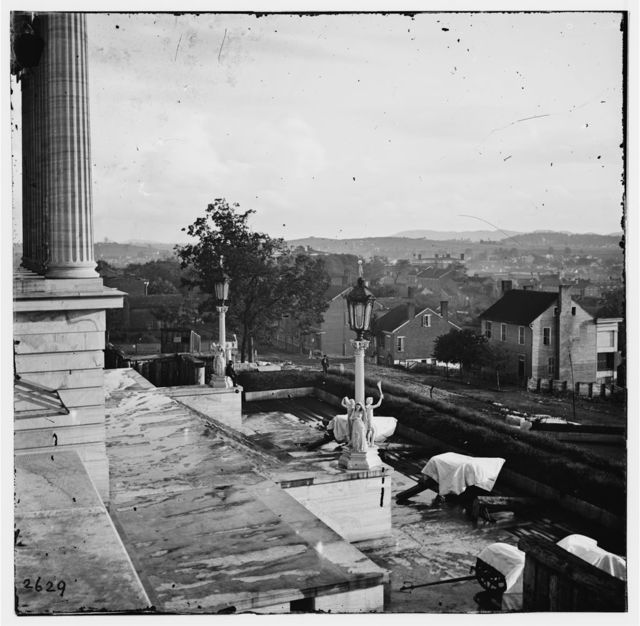 [Nashville, Tenn. Steps of the Capitol with covered guns; vista of the city beyond]