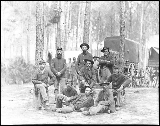 [Petersburg, Va. Group of Company B, U.S. Engineer Battalion; wagons in background]