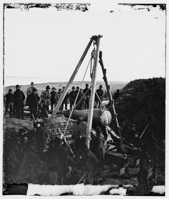 Savannah, Georgia (vicinity). Army engineers removing a 48-pdr. 8-inch Columbiad from Fort McAllister