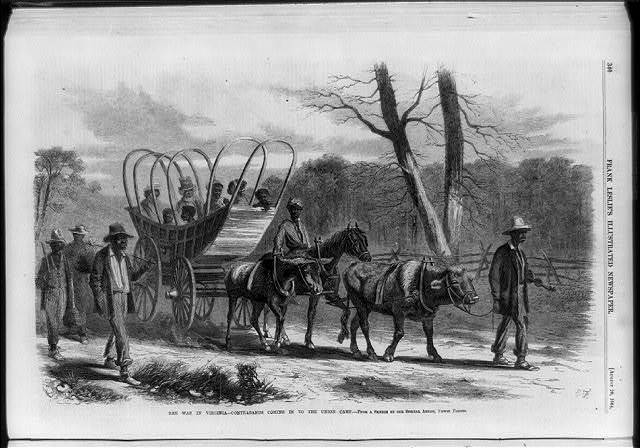 The war in Virginia - contrabands coming in to the Union camp  [Blacks in wagon and walking]