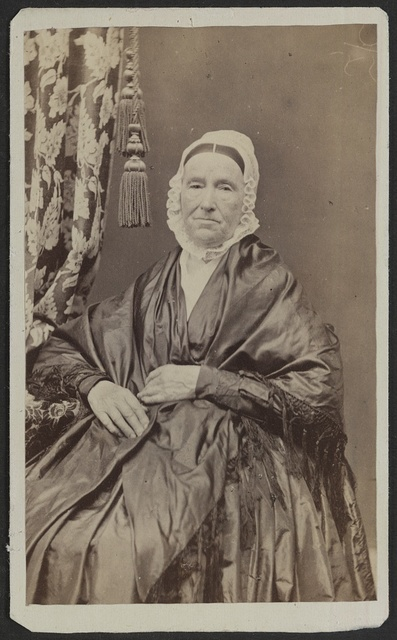 [Unidentified elderly woman in shawl and cap] / J. St. John, photographer and dealer in photographic albums, and oval rosewood and gilt frames, Elkhorn, Wisconsin.