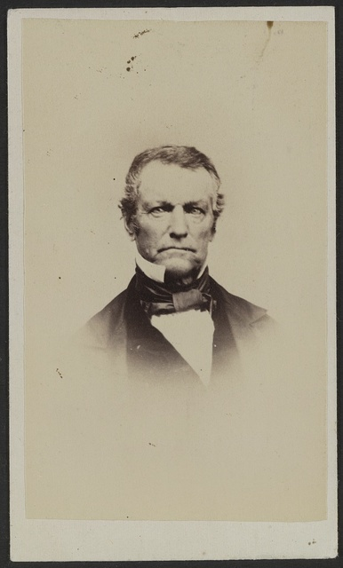 [Unidentified man] / J. St. John, photographer and dealer in photographic albums, and oval rosewood and gilt frames, Elkhorn, Wisconsin.