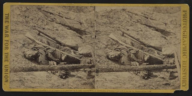 """A dead rebel soldier, as he lay in the trenches of Fort Mahone, called by the soldiers """"Fort Damnation"""""""