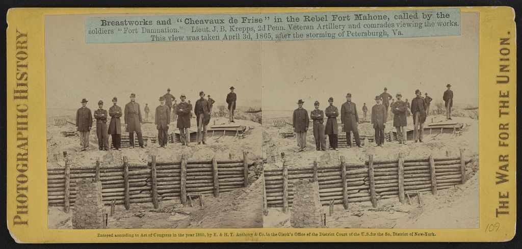 """Breastworks and """"Cheavaux de Frise"""" in the Rebel Fort Mahone, called by the soldiers """"Fort Damnation""""--Lieut. J.B. Krepps, 2d Penn. Veteran Artillery and comrades viewing the works"""