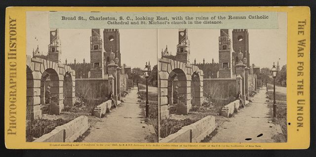 Broad St., Charleston, S.C., looking East, with the ruins of the Roman Catholic Cathedral and St. Michael's church in the distance