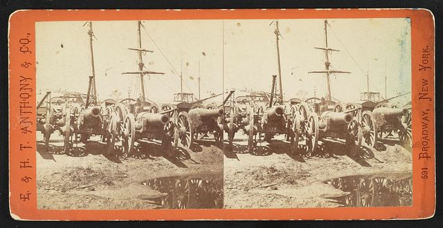 Captured guns at the Rocketts, Richmond, Va. The vessels at the docks are shipping them for transportation to Fortress Monroe