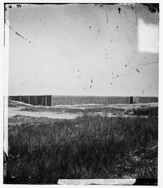 Charleston, South Carolina (vicinity). Stockade on Morris Island where Confederate prisoners were confined under fire in retaliation for placing  Federal prisoners under fire in Charleston