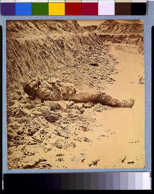 Dead Confederate soldier, in trenches of Fort Mahone in front of Petersburg, Va., April 3, 1865