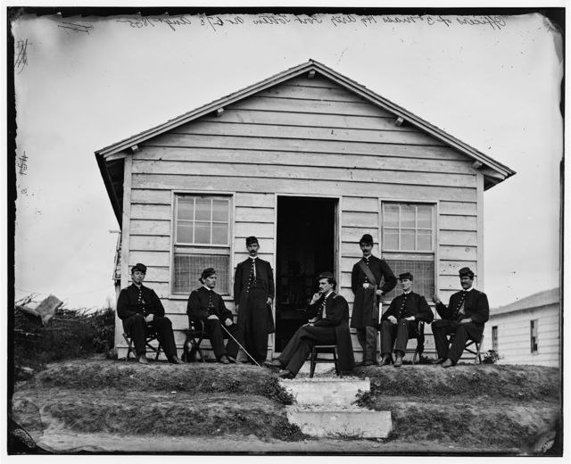 [District of Columbia. Officers of Companies A and B, 3d Massachusetts Heavy Artillery, before quarters at Fort Totten]