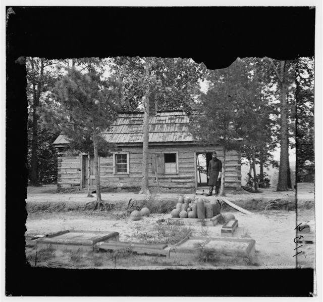 Drewry's Bluff, Virginia. Chaplains quarters. 1st Conn. Heavy Artillery in Confederate Fort Darling. Part of shot and shell in foreground was fired by U.S. Gunboats in attack on fort in 1862