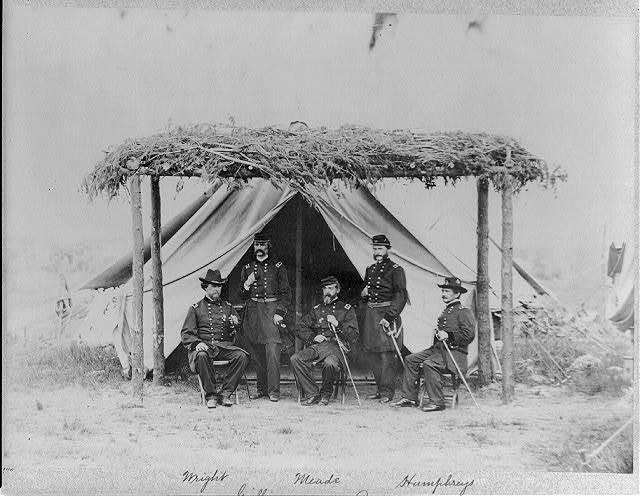 [Generals of the army of Potomac: Wright, Logan, Meade, Parke, Humphreys posed under trellis tent awning]