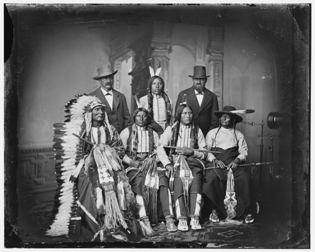 "Group of Sioux Indians  ""Spotted Tail"" (photo c. 1875) Standing: Joe Merrivale; Young Spotted Tail; Antoine Janis; Seated: Touch-the-Clouds; Little Big Man; Black Cool; last two  are rapoves[?] indentified by George E. Hyde 4229 Dangler[?] St. Omaha, Neb."