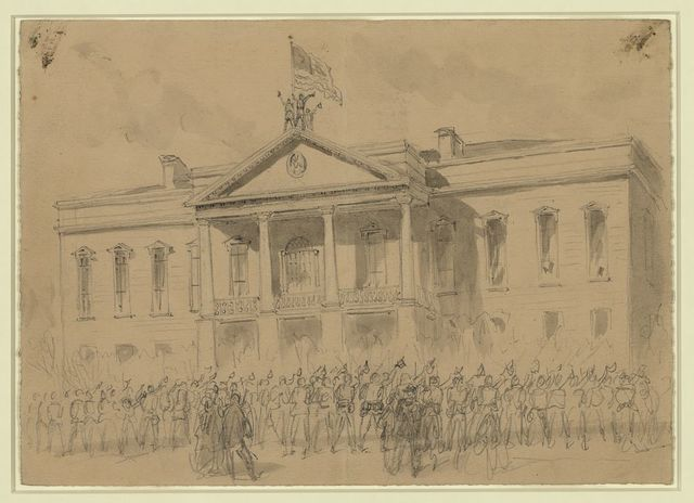 Lt Col Kennedy of the 13th Iowa, 3rd Brigade, 4th Division, 17 A.C. raising the stars & stripes over the State House Columbia