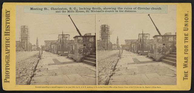 Meeting St., Charleston, S.C., looking South, showing the ruins of Circular church and the Mills House, St. Michael's church in the distance