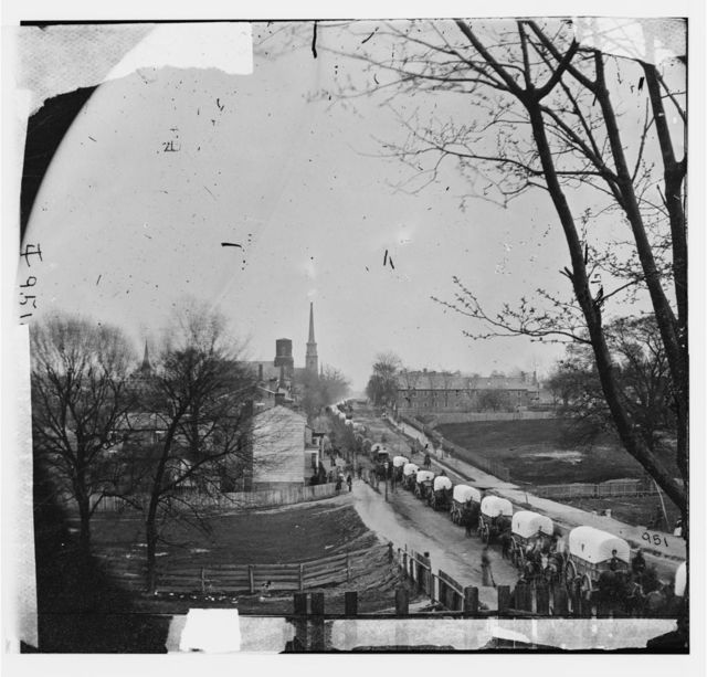 [Petersburg, Va. The first Federal wagon train entering the town]