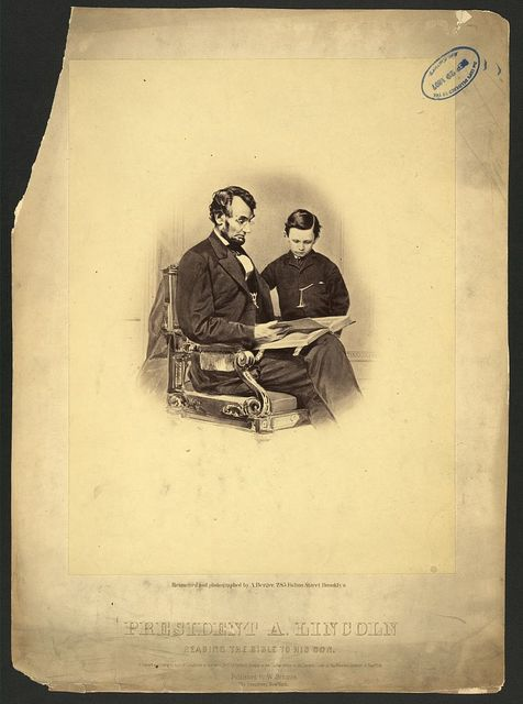 President A. Lincoln reading the Bible to his son / retouched and photographed by A. Berger, 285 Fulton Street, Brooklyn.