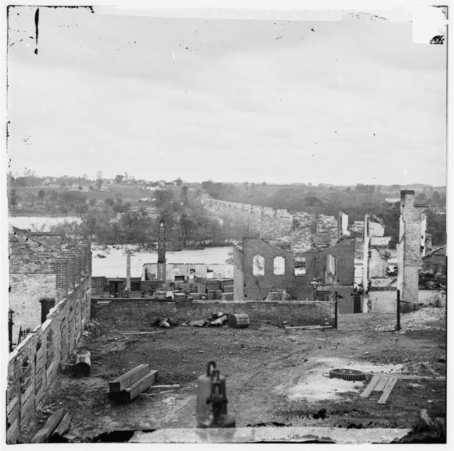 [Richmond, Va. Ruins of Richmond & Petersburg Railroad bridge; south bank of the James beyond]